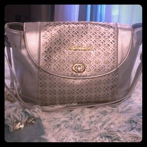 MK purse and earrings silver in color. Preowned